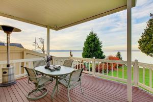 Awesome Water View from the Covered Wooden Deck with White Railings project from our Deck Builder