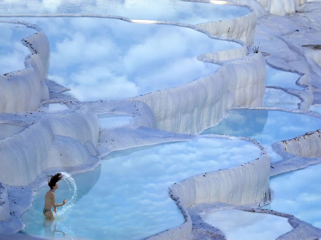 in-the-province-of-denizli-in-western-turkey-the-naturally-terraced-thermal-springs-of-hierapolis-pamukkale-date-as-far-back-as-the-second-century-bc-formed-by-calcite-in-the-water-the-hot-springs-look-like-stunning-white-clouds
