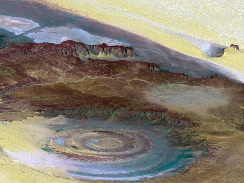 The-richat-structure-also-known-as-the-eye-of-the-sahara-se mantiene-como-uno-grande-bullseye-en-el-medio- Diámetro-que-se extiende-casi-30-millas-él-es-pensado-para-ser-el-resultado-de-erosión-y-permanece-como-una-maravilla-para-científico