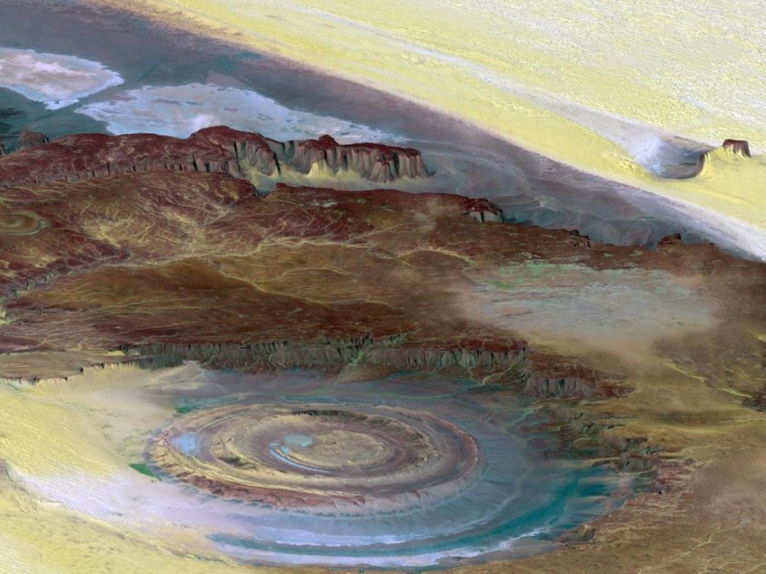 the-richat-structure-also-known-as-the-eye-of-the-sahara-stands-as-a-large-bullseye-in-the-middle-of-the-sahara-desert-with-a-diameter-that-spans-almost-30-miles-it-is-thought-to-be-the-result-of-erosion-and-stands-as-a-marvel-for-scientist