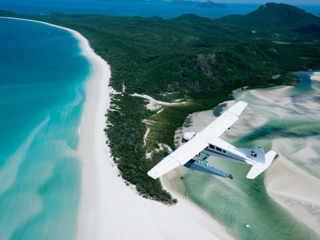 whitehaven-beach-in-whitsunday-island-australia-hosts-a-cove-where-the-tide-shifts-the-sand-and-waters-together-creating-a-breathtaking-combination-white-sands-and-turquoise-waters-seem-to-blend-seamlessly-to-make-for-a-marvelous-view
