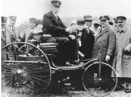 Karl Friedrich Benz in his first automobile. (Reproduced courtesy of the Library of Congress.)
