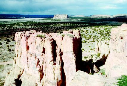 The Enchanted Mesa, in Acoma Pueblo, New Mexico, rises 430 feet from the desert valley