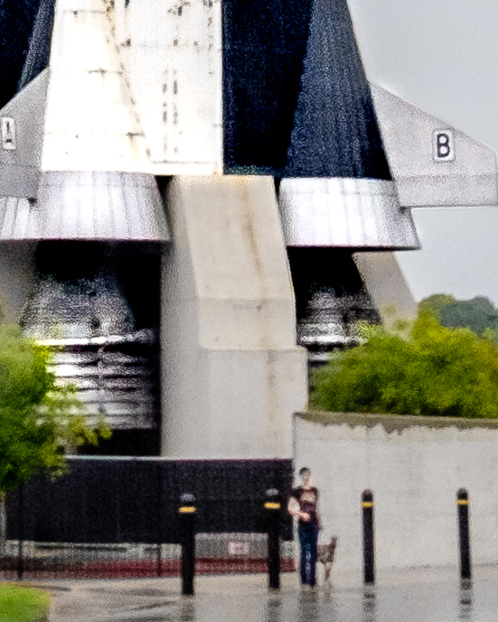 "Close up of Kuiper and I standing next to the Saturn V. According to my friend, we look like ""blurry ants."""