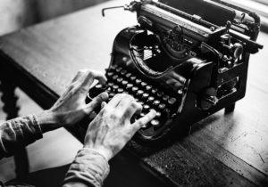 hands on a typewriter