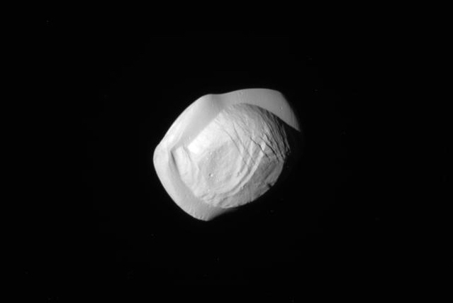 Strange Shape of Saturn's Moon Pan Revealed by Cassini