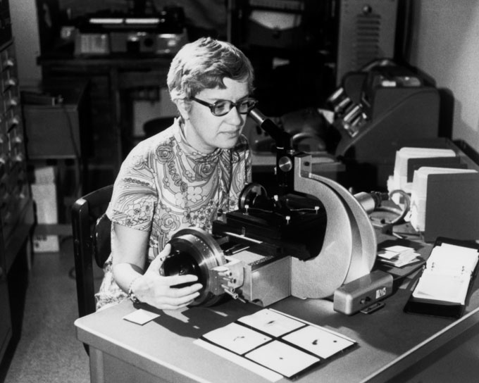 black and white photograph of Vera Rubin seated at a desk