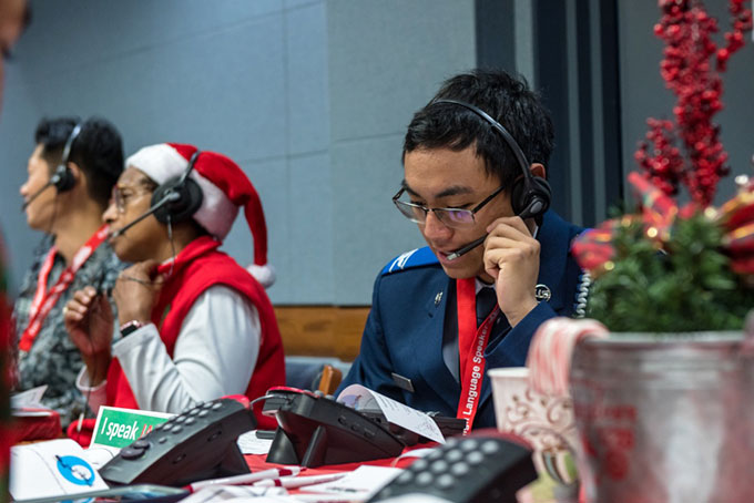 a photo of some of the volunteers taking phone calls at NORAD headquarters in 2019