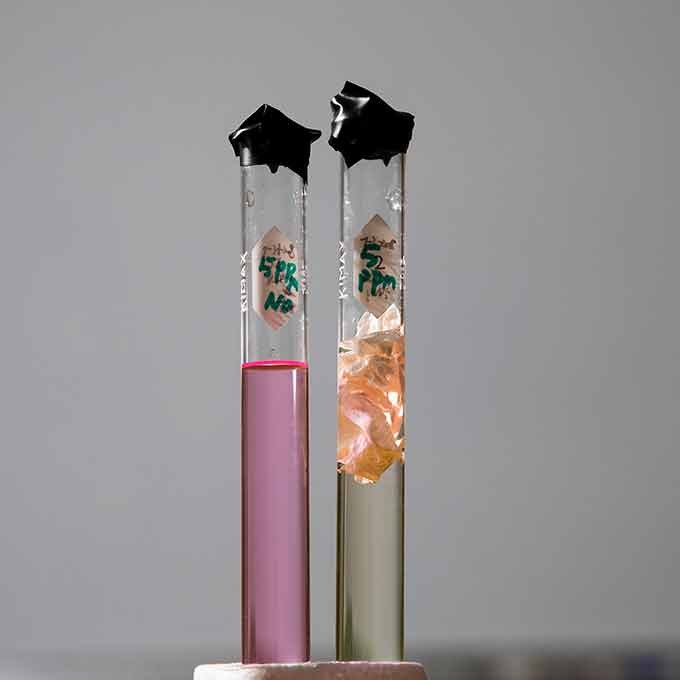 two vials of dye solution showing how dye degrades
