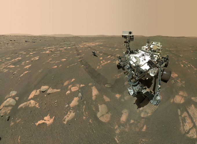 selfie image of Perseverance rover with Ingenuity helicopter in the background