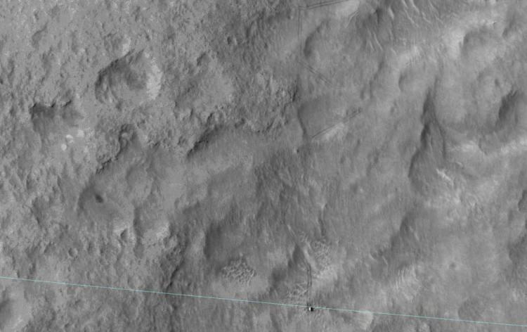 De blauwe lijn geeft de grens van het landingsgebied aan. Afbeelding: NASA / JPL-Caltech / Univ. of Arizona.