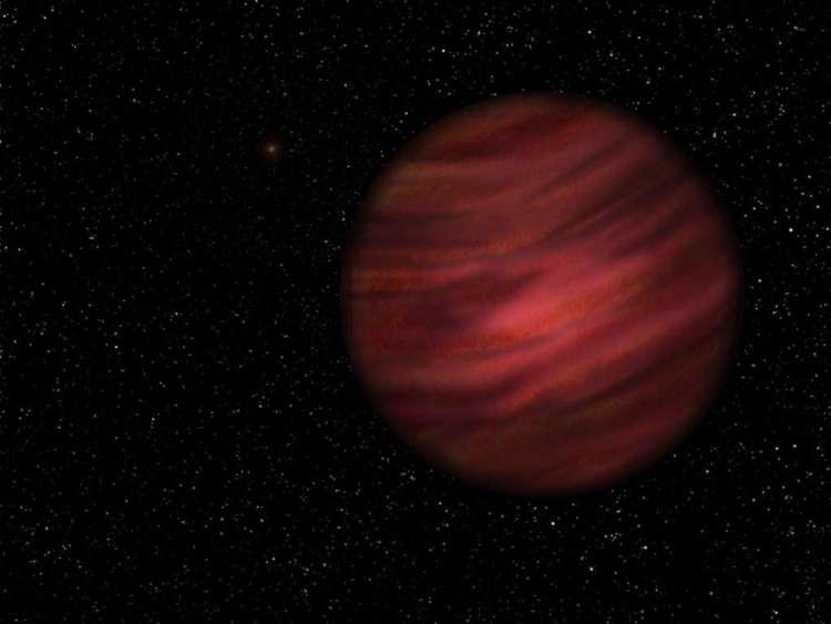 De exoplaneet 2MASS J2126-8140. Als je goed kijkt, zie je op de achtergrond (links) nog de ster waar deze op zeer grote afstand omheen cirkelt. Afbeelding: University of Hertfordshire / Neil James Cook.