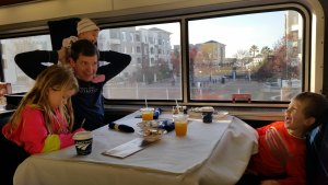 Hamming it up with all 3 kids in the Amtrak train dining car