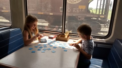 Playing cards on the train to pass the time