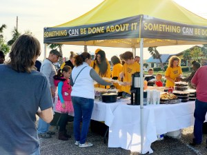 Scientology volunteers operate a relief station with food for volunteers