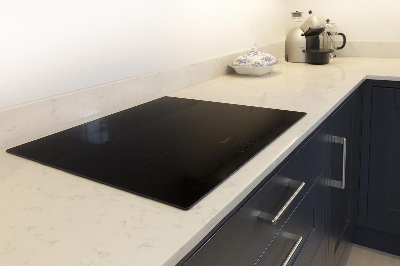black stainless steel kitchen quiet hood devon worktop projects in granite and caesarstone