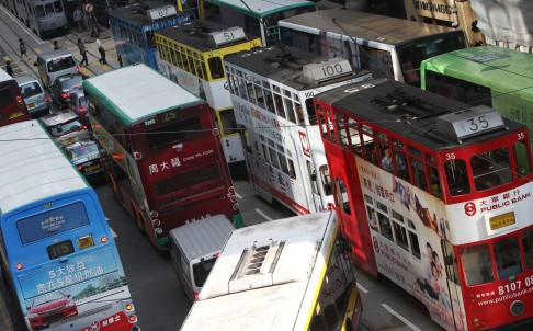 Minibuses and buses carry 71 per cent of total daily passenger boardings, but account for only 5 to 25 per cent of traffic on major roads. Photo: David Wong