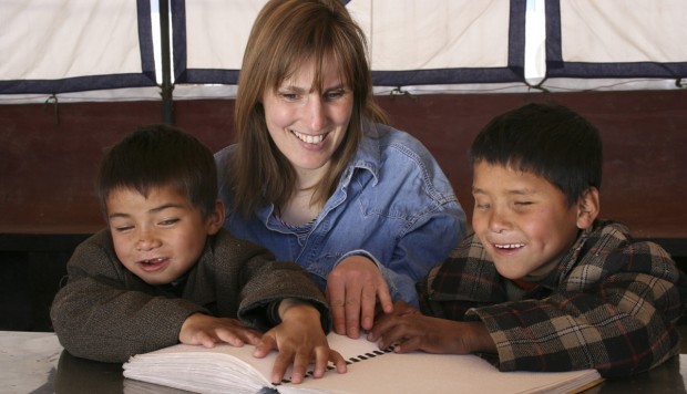 Sabriye Tenberken, who lost her sight as a child, with students at the school for the blind she founded in Lhasa, Tibet.