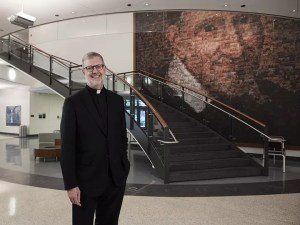 The Rev. Dennis H. Holtschneider, C.M., president of DePaul University, is seen in a portrait in the McGowan South science building on DePaul's Lincoln Park campus quad Monday June 29, 2015. (DePaul University/Jeff Carrion)