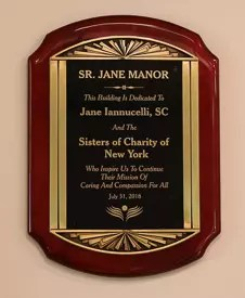 "Plaque reads, ""This building is dedicated to Sr. Jane Iannucelli, SC, and the Sisters of Charity of New York, who inspire ust to continue their mission of caring and compassion for all. July 31, 2018"
