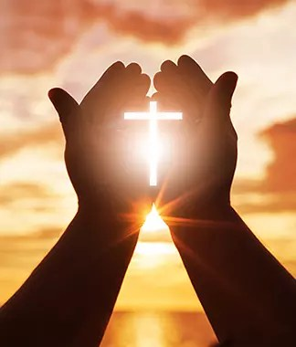 Hands holding light of Christ