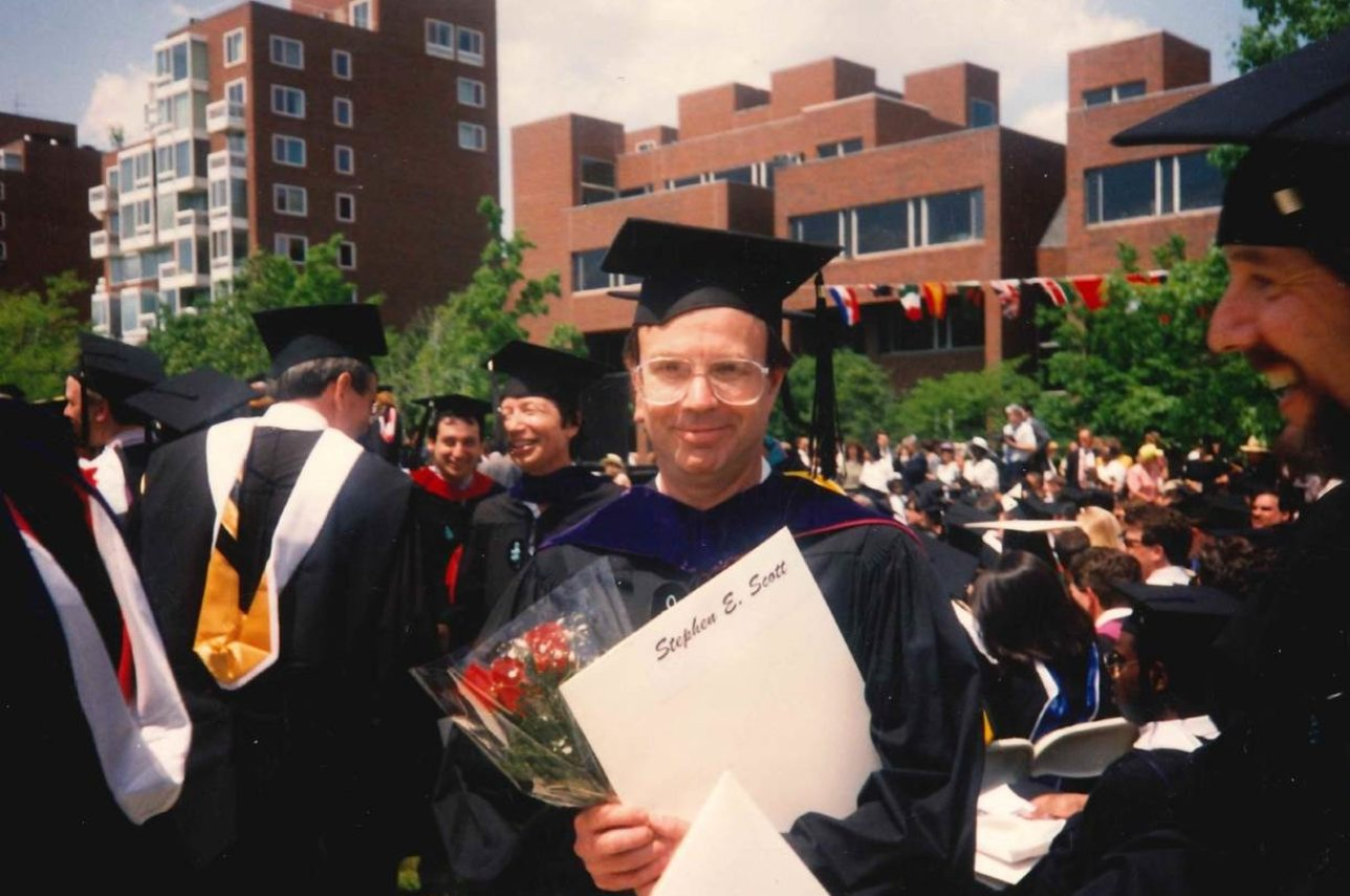Photo of Steve in graduation gown