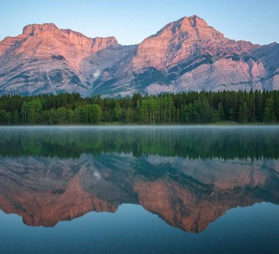 A landscape photograph of sunrise Wedge Pond Alberta.