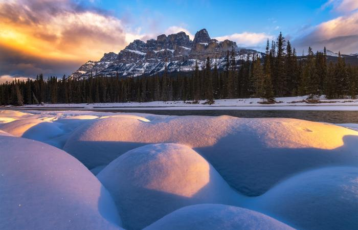Landscape Photography in the Canadian Rockies. A photo of Castle Mountain taken during a Marc Adamus workshop. Snow pillows and morning light in the foreground.