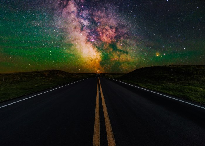 Night photography of the highway to Val Marie with the milky way aligned in the center