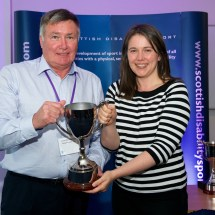 Gordon McCormack OBE receiving the Special Olympics Trophy on behalf of Elaine McKenna