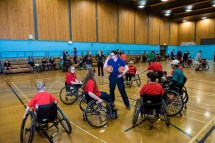 Jen Scally from SDS directing wheelchair basketball players on court