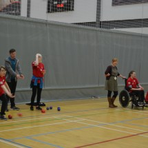 Five participants trying boccia throws