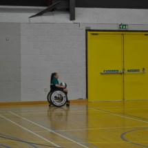 Girl carrying basketball in wheelchair