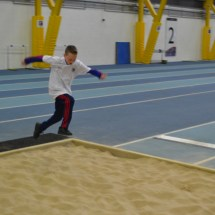 Boy practicing long jump