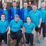 Scottish para badminton players group photo of Alan Oliver, Colin Leslie, Niall Jarvie, David Purdie, Bobby Laing, Deidre Nagel, Fiona Christie outside the venue