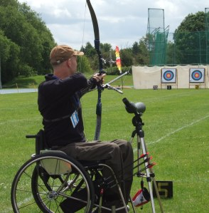 Brad Stewart taking aim at archery target