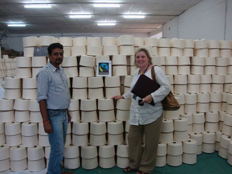A man and a woman posing with a Fairtrade logo in the middle.