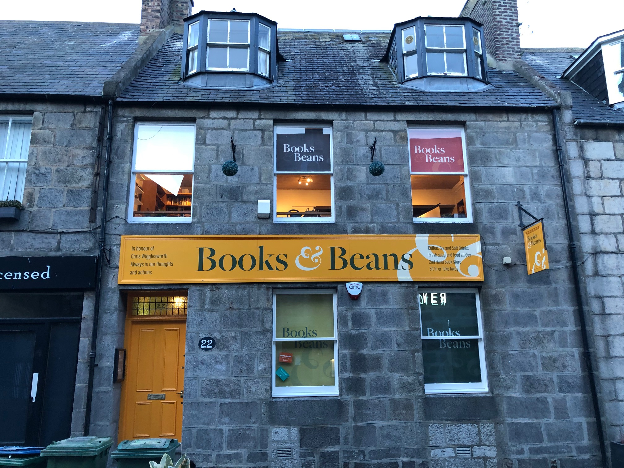 A picture of the front building of the Books & Beans coffee shop
