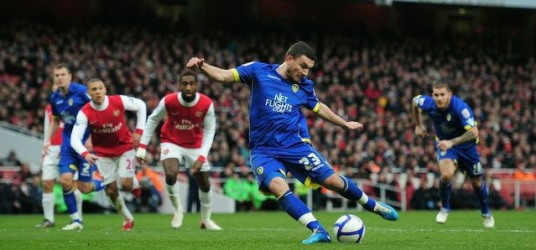 Snodgrass scoring a penalty against Arsenal
