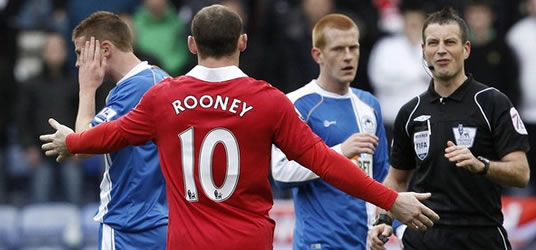Wayne Rooney protesting after elbowing James McCarthy