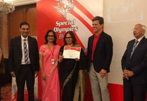Dr Kartikay Saini - Receiving Unified Champion School Award from Mr. Tim Shriver Chairman Special Olympics International