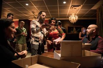 Signing CDs before the show begins - that's the back cover of my book you can see in the box.