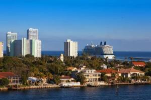 Cruise Ship leaving Fort Lauderdale port behind condo buildings image