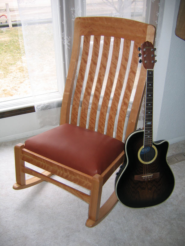 guitar shaped chair house of orange rattan rocking chairs rock to your own music