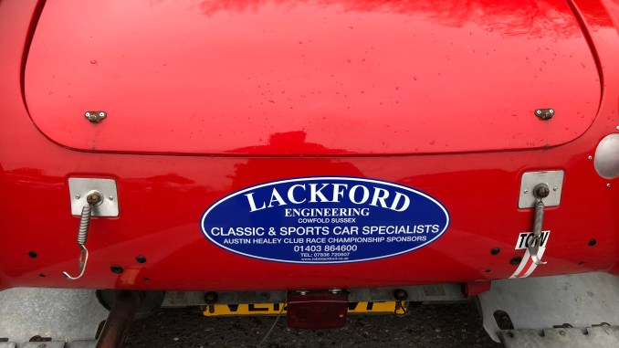 This is the rear view of a Robin Lackford sponsored Spridget at Brands Hatch
