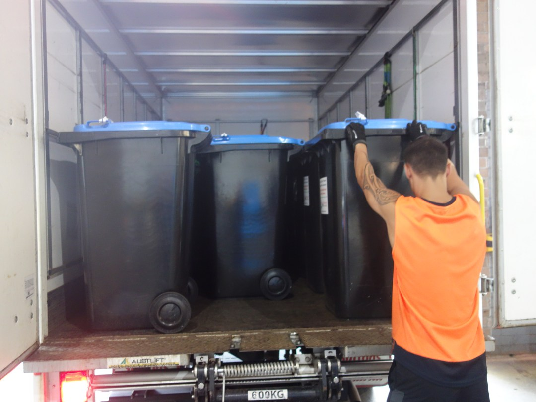 Blue Bins being unloaded at the depot