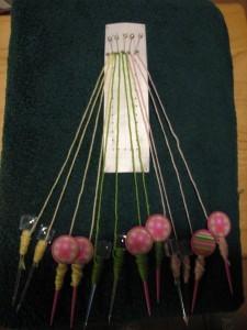Pattern, pins, bobbins and yarn for cloth stitch (bobbin lace)