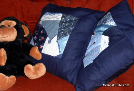 Two crazy-quilted pillow covers, all ready for snuggling.