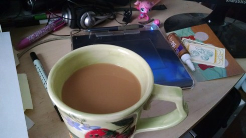 Yummy coffee on a messy desk... such is my life!