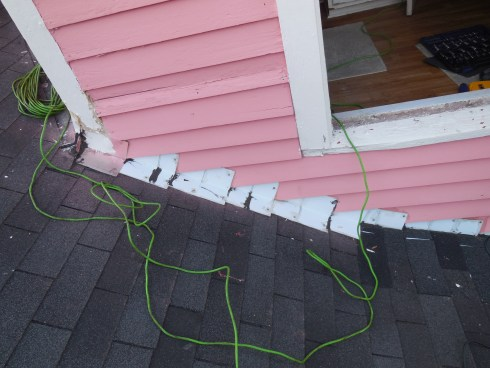 """The """"beautiful"""" job they did of adding in the afterthought flashing--photo by Todd this January while he was up on the roof (because you know I'm not getting out there!)"""